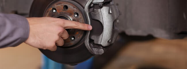 brake pad replacement by Meineke technician