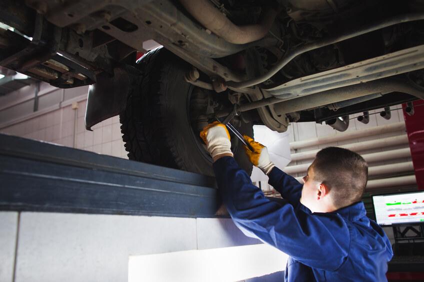 Mechanic repairing tires